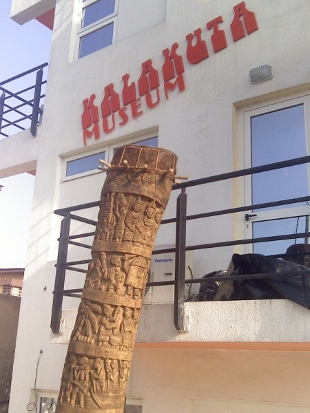 The 'world's tallest drum' (Kalakuta Museum in the background)