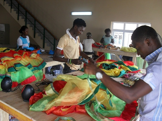 Youths at work on the carnival costumes