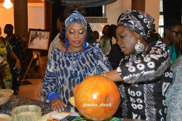 Ogun State Commissioner for Culture & Tourism, Mrs Yewande Amusan, pours Yeni Kuti (Fela Anikulapo-Kuti's first daughter, a serving of palmwine