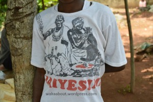 A young boy IN oSOSA wears a T-shirt inscribed with the title of one of Ogunde's films--JAIYESIMI