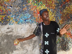 The Recycler: Lanre Tejuoso standing in front of one of his installations at Aroko green Museum