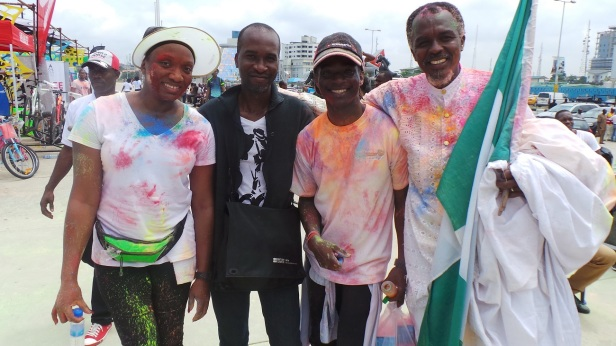 The author, Pelu Awofeso (2L) with some participants at the Colour Splash. At the exterem right is the World Wrapperman, David Adjarho Obaro, the official mascot for the event