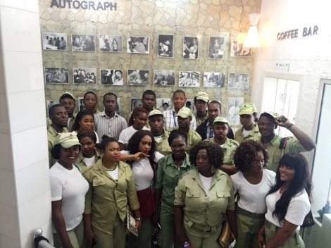 The Corps members take a group photograph by the Autograph gallery of the library. Image courtesy of Chika Uwadoka