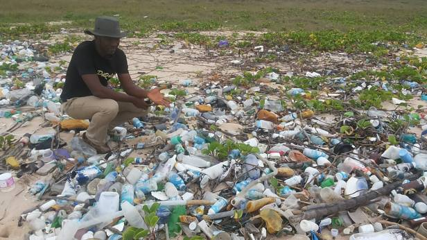 Beach Samaritans Co-Founder Pelu Awofeso at the littered Regal Seaview Beach, Lekki
