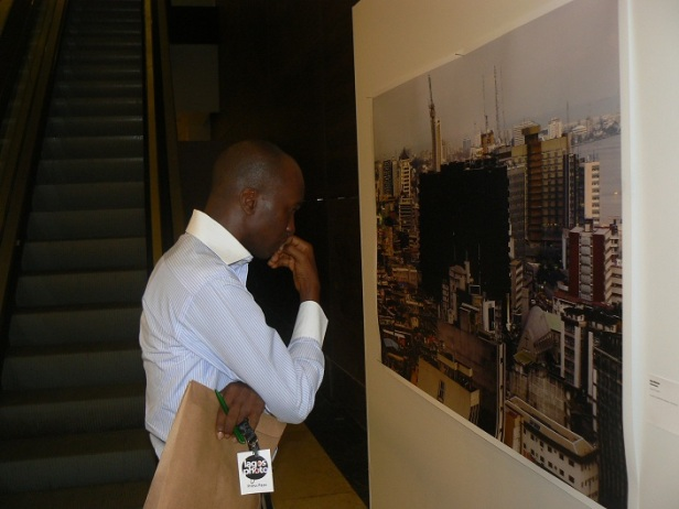 Pelu Awofeso viewing an exhibit at LagosPhoto 2012
