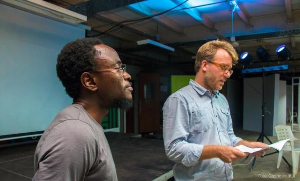 Ayodele Arigbabu (Curator, African Futures Lagos standing with Marcandre Schmachtel, Director Goethe Institut (Nigeria) on the opening night of African Futures
