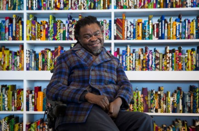 MARGATE, ENGLAND - MARCH 22:  Yinka Shonibare MBE with his work The British Library at Turner Contemporary as part of the 14-18 NOW programme. The work is on display until 30 October. at Turner Contemporary on March 22, 2016 in Margate, England.  (Photo by John Phillips/Getty Images for 14-18 NOW) *** Local Caption *** Yinka Shonibare MBE